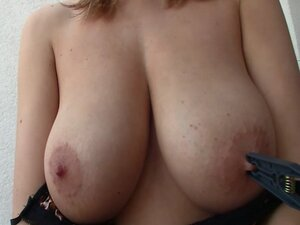 Shelby oiling her giant boobs