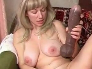 Old lady has solo sex with a huge toy