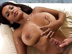 A bombshell of an Indian chick with a lovely set of bazookas gets cummed on