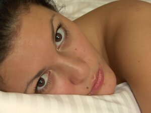 Big brown eyes on naked teenager