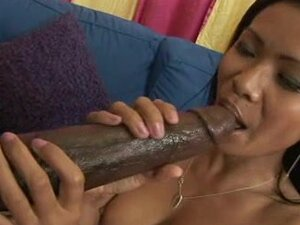 Perverted Asian babe Priva is sucking black rubber dick