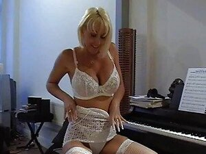 Busty blonde milf in sexy lace lingerie fingers her wet muff