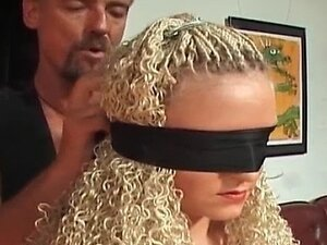 Hot curly blindfolded blonde gets her ass spanked