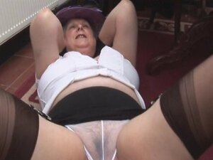 Busty hairy mature granny in stockings spreads and shows off big hairy pussy