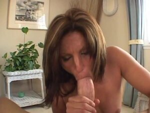 Jackie Moore shoves this hard cock down her throat