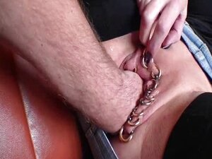 Fist fucking her heavily pierced gaping cunt