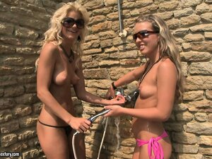 Two heated up bikini babes offered to share a cock by the pool