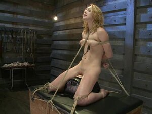 Scorching hot Lily Luvs is tied up on top of a toy