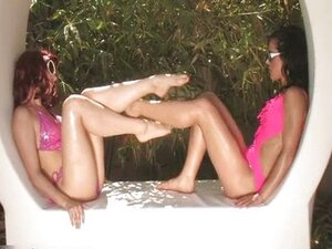 Two hot babes with sexy long legs having