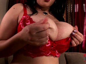Busty as all fuck brunette babe plays with her gigantic breasts