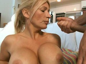 Cougar milf letting two young men jizz all over her pretty face