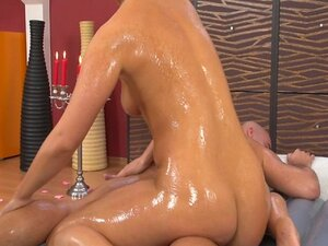 Slippery massage babe gets fucked with a big bone deep