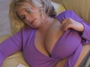 Busty blond milf is so bored so that she entertains herself