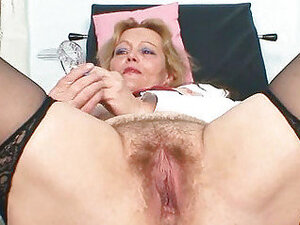 Filthy mature lady toys her hairy pussy with specu
