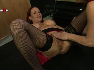 A couple of mature redhead lesbians start with a dildo and move to fisting