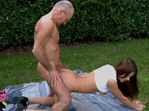 A promiscuous brunette teen taking on an older guy in an outdoor scene.